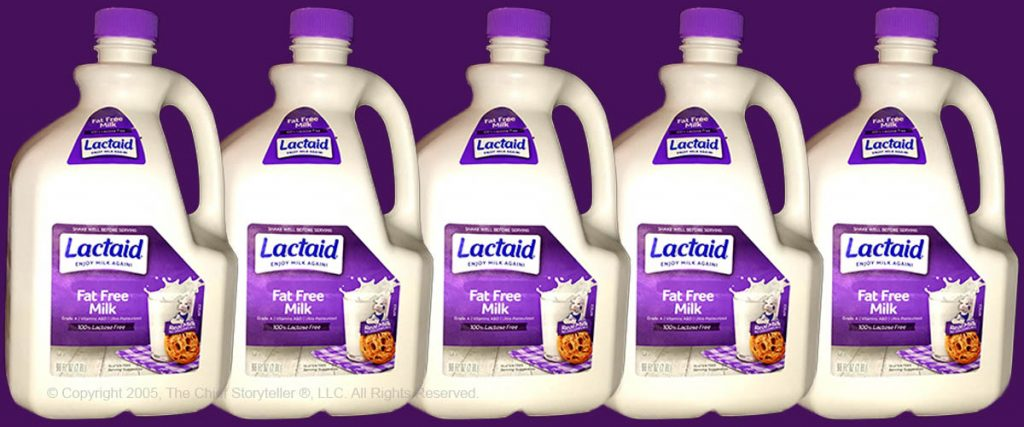 five milk cartons, size by side with small overlap, Lactaid fat free, purple top and background, talk fat free