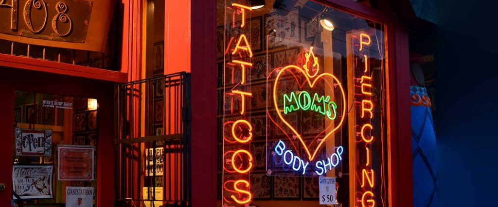 night picture of tattoo parlor store front