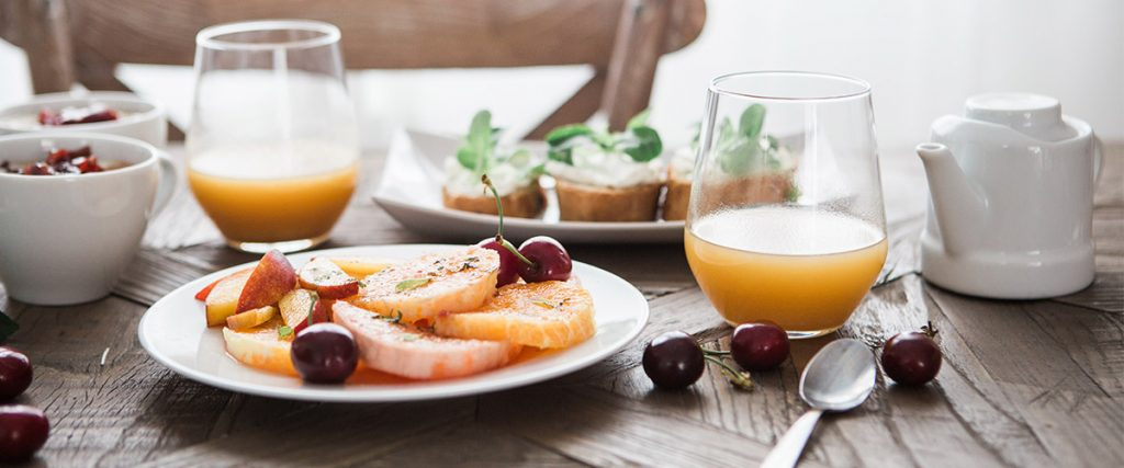 networking event with tasty breakfast spread with orange juice and fruit, need elevator pitch, your core story