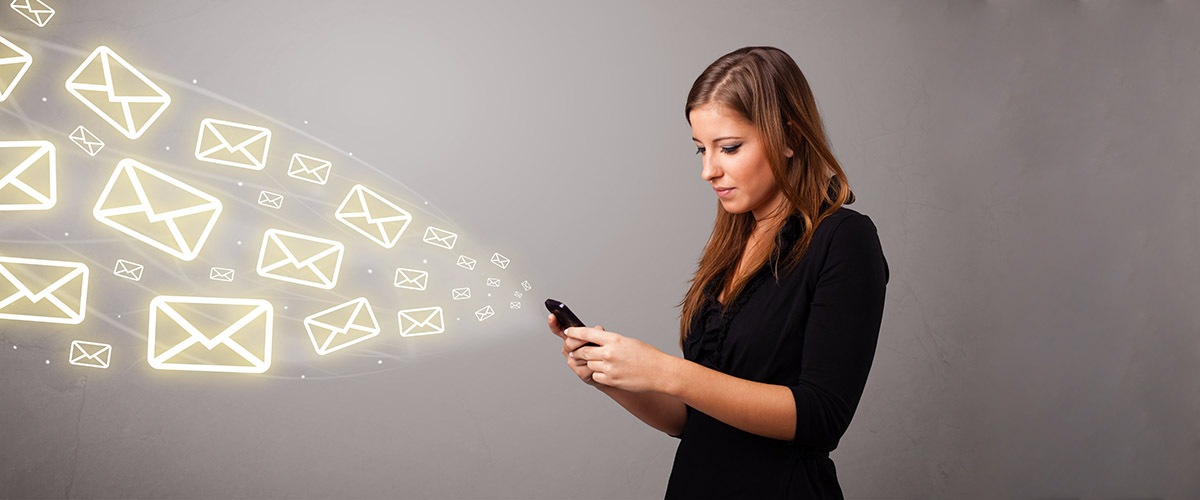 female, woman, executive, looking at email on her mobile, also write email responses
