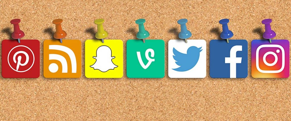engage your followers, social media icons on cork board with push pins - pinterest, blog, snapchat, twitter, facebook, instagram