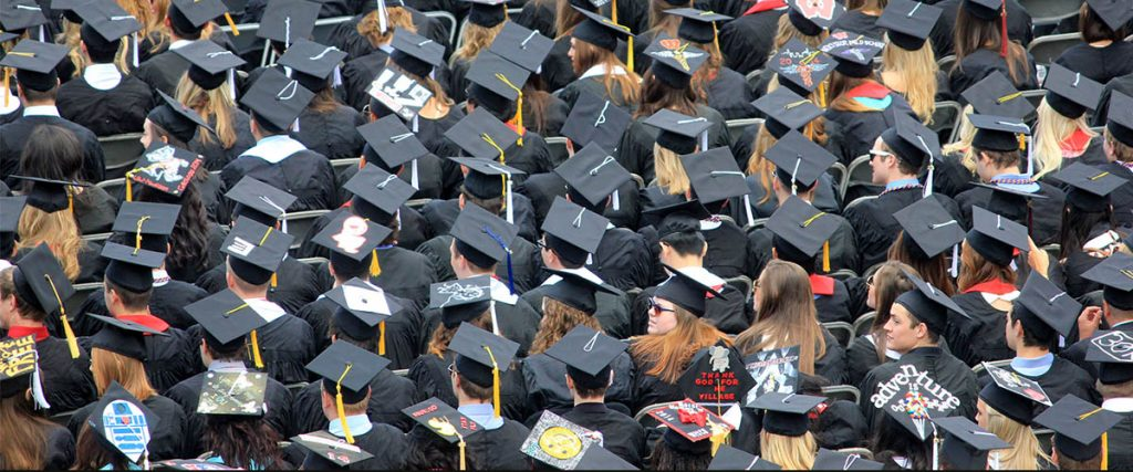 college graduation, view from high of the students with their hats