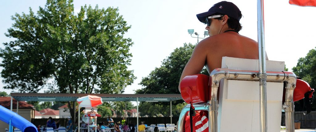 life guard at us air force base, young male, in life guard chair, smile