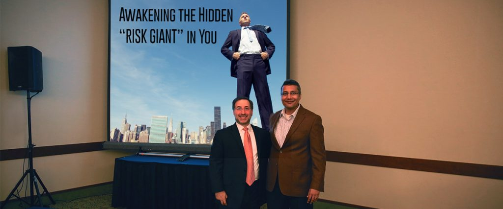 Ira Koretsky and Bhavest Bhagat after their keynote to ISACA. Standing side-by-side, smiling, with title slide in the background