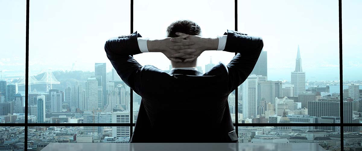 relaxed or lazy ceo, fingers intertwined behind his head, overlooking beautiful skyline