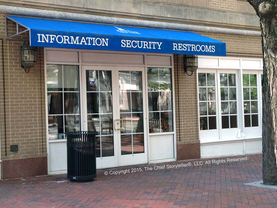 funny picture of an awning with information then security then restrooms such that put together it becomes information security restrooms