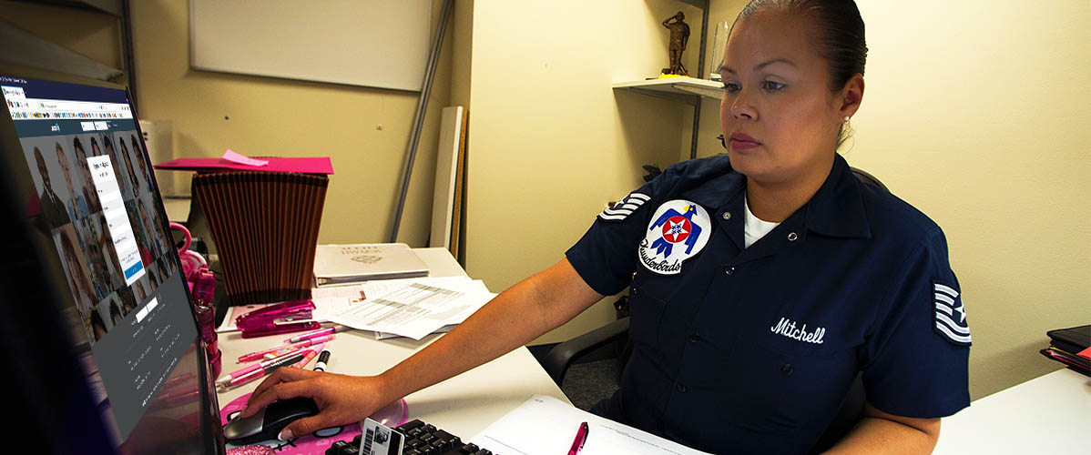 US Airforce Airman at her computer looking at LinkedIn