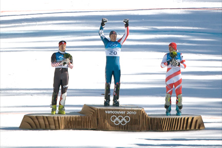 olympic medal ceremony, vancouver 2010, gold medalist holding arms up in triumph