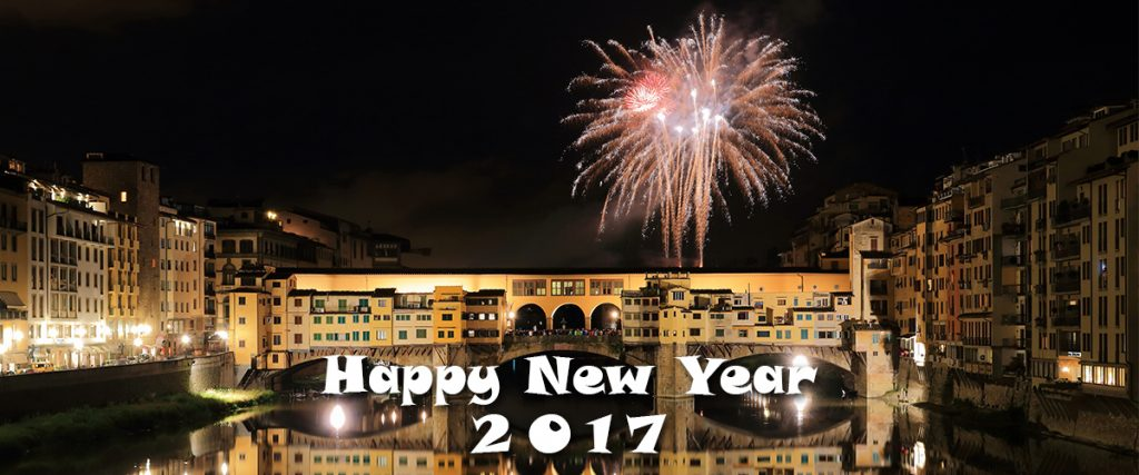 happy new year 2017 with fireworks going off over the Ponte Vecchio, Old Bridge, in Florence, Italy