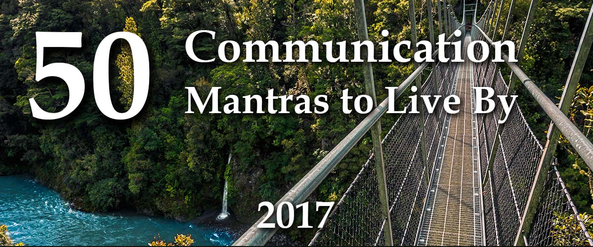 Pedestrian suspension bridge over a beautiful blue river with overlay text 50 business storytelling mantras to live by 2017