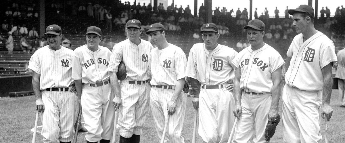 black and white, from 1937 baseball all stars, 7 players from different teams, in front of official photographer