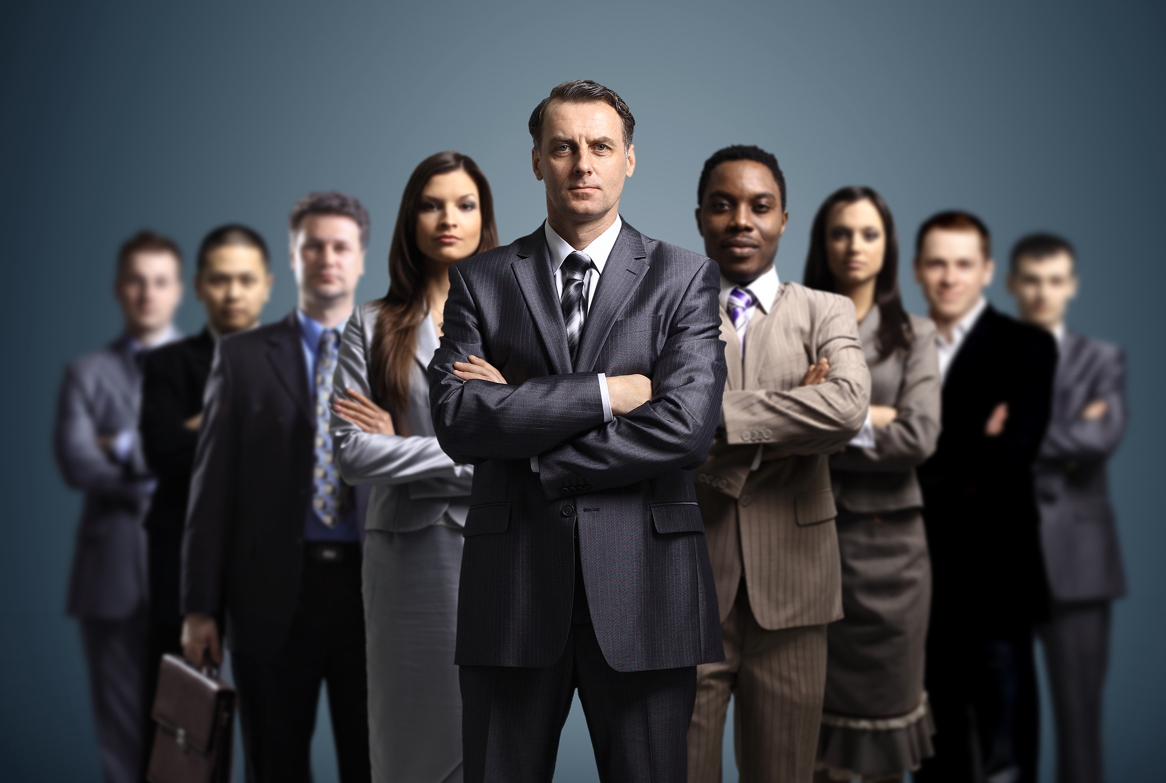 success story 02 showing an arrow arrangement with a variety of executives having their arms crossed exuding confidence, trust, and seriousness