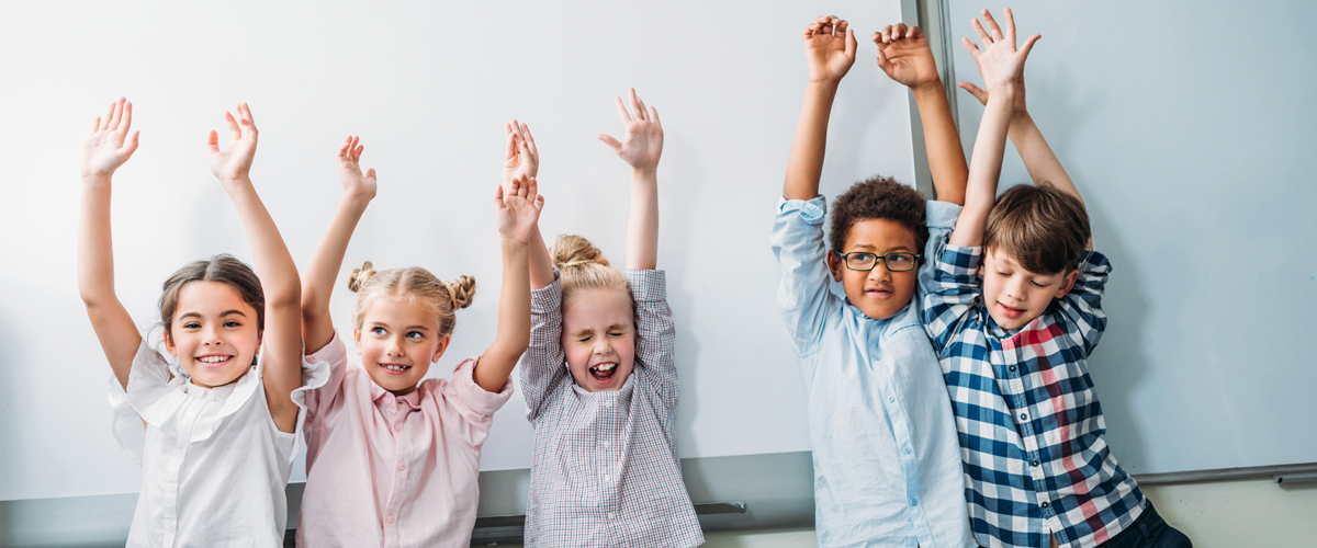 happy teacher appreciation day with children arms raised in a happy gesture