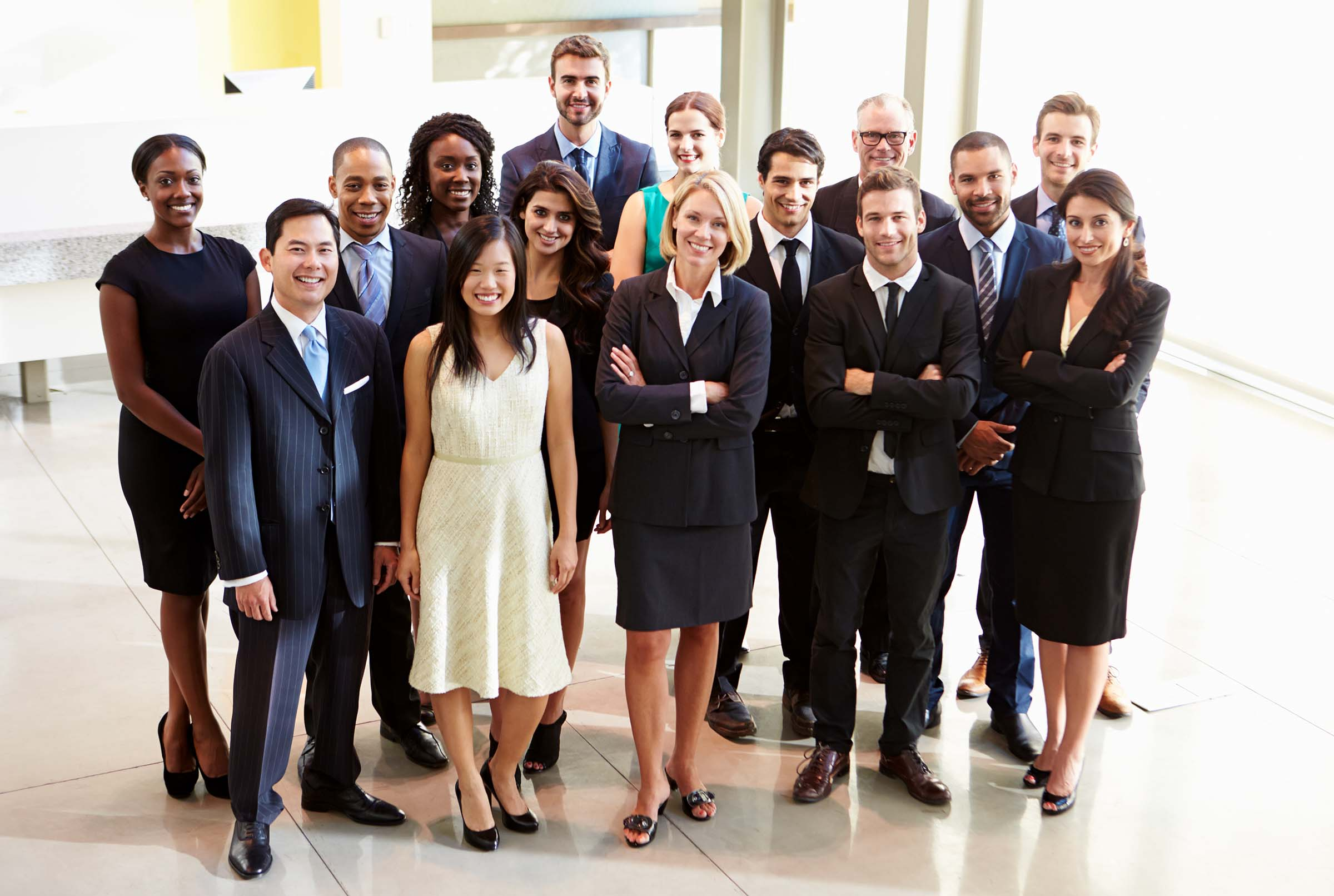 success story oxya multi-ethnic team of 20 executives, smiling, confident, for oxya success story