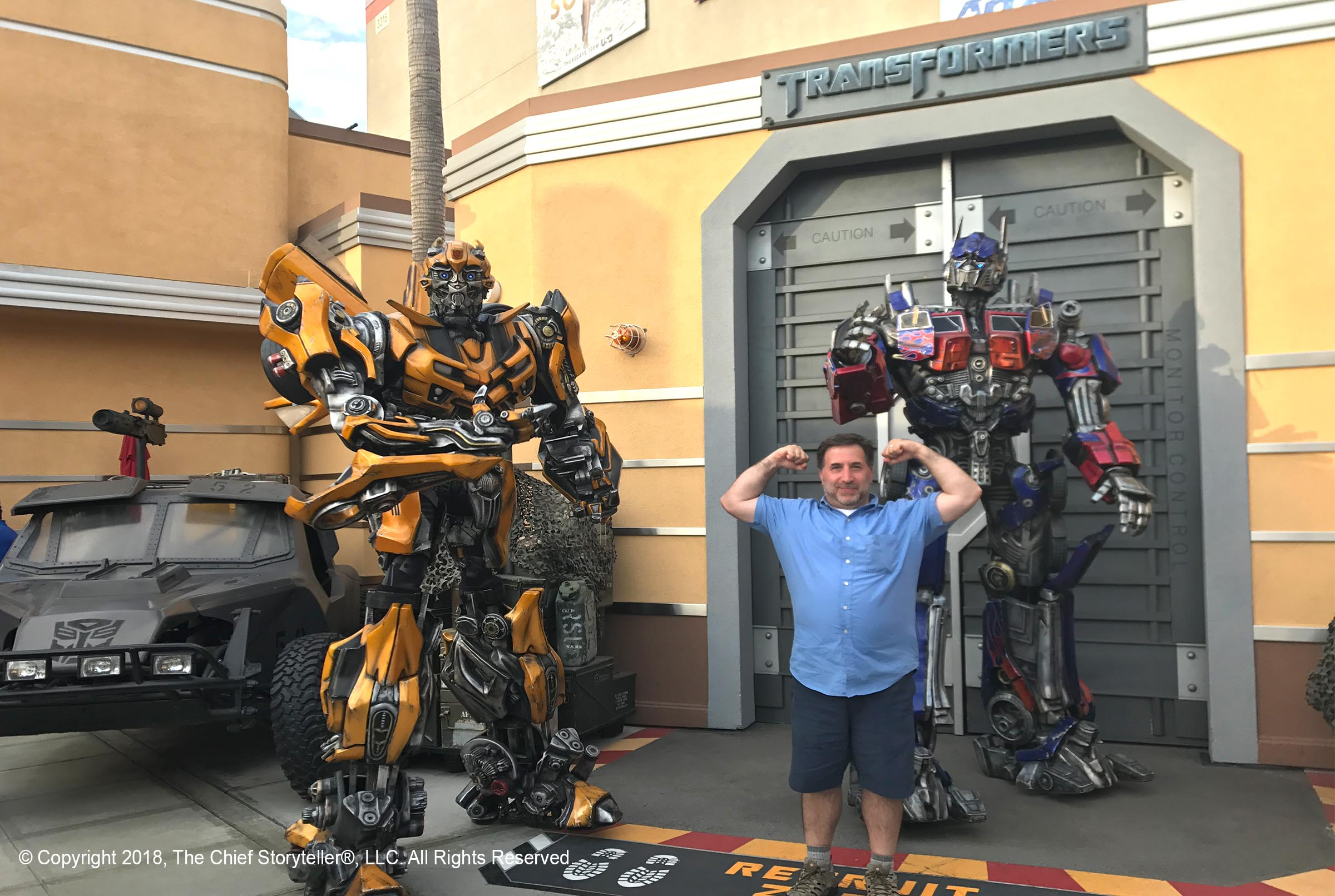 ira koretsky at universal studios with transformers in background, showing muscle pose for nFusion Nassal company