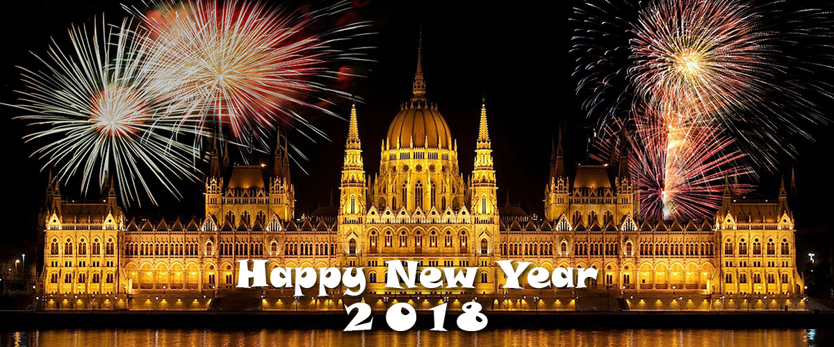 happy new year 2018 with fireworks going off over the Parliament Building in Budapest, Hungary