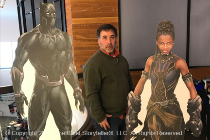 ira koretsky, black panther movie, standing in between cardboard cut outs of black panther and his sister, shuri