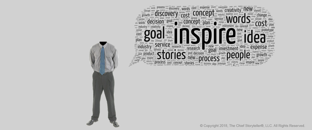word cloud - message cloud with inspire at the center, black text on gray background, executive with arms behind back