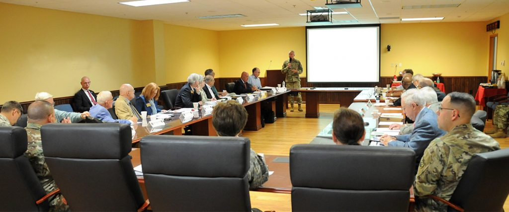 conference room for US Army, mixed attendance of military and civilian, general officer presenting to group