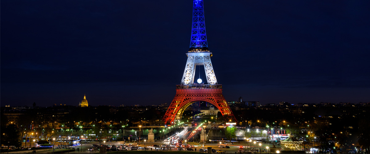 eiffel tower at night, bright lights, red, white, and blue, visit to europe, importance of asking questions
