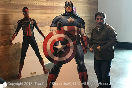 ira koretsky, infinity war movie, standing next to cardboard cut out of Captain America