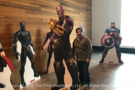 ira koretsky, infinity war movie, standing next to cardboard cut out of Thanos, which seems to be about 8 feet tall