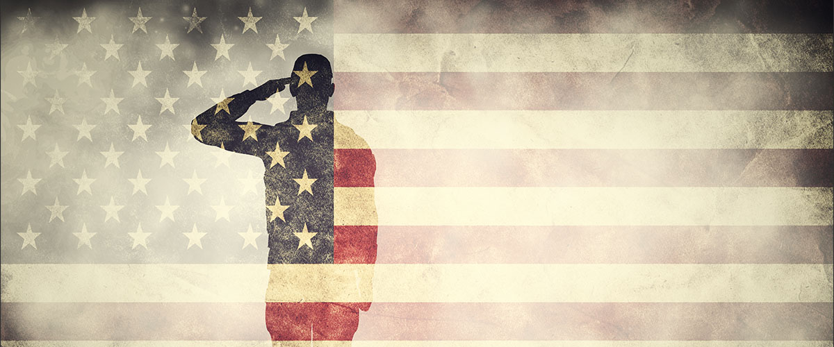 veterans day 2018 - silhoutte of saluting military member with overlay of us flag