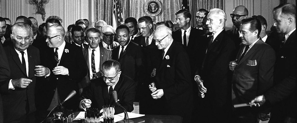 Lyndon_Johnson_signing_Civil_Rights_Act,_July_2,_1964 - martin luther king, jr holiday