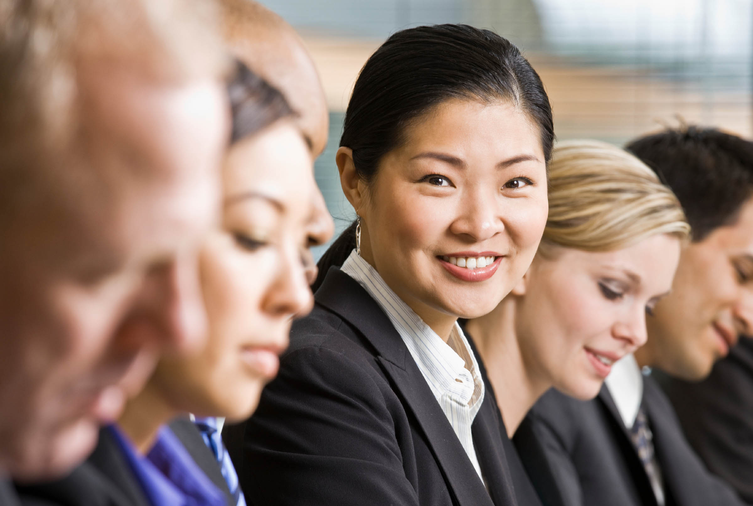 success story portfolio for carr workplaces executive, asian woman, smiling, confident, for carr workplaces success story