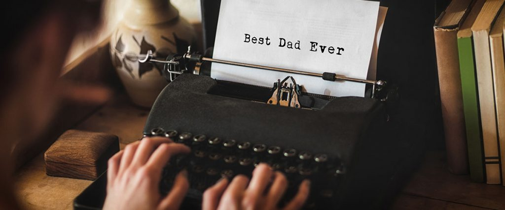 "hands typing on old school typewriter, ""Best dad ever"" to underscore message for business story of importance of his dad"