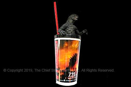 ira koretsky's favorite cup - godzilla. from 2014holding several godzilla dvds, a glow in the dark godzilla, and pointing to Godzilla on his t-shirt