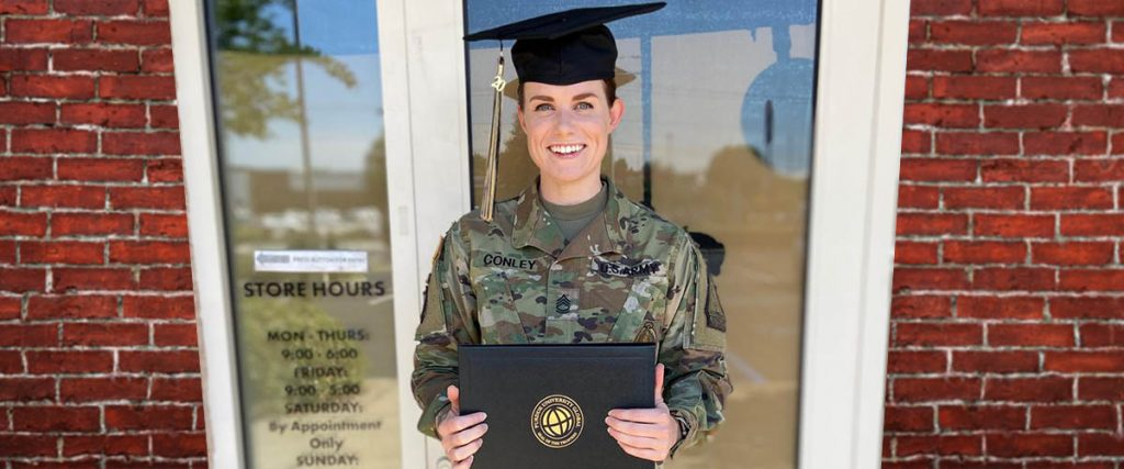 beat the odds - new college graduate Brittany, in US Army uniform, with graduation cap